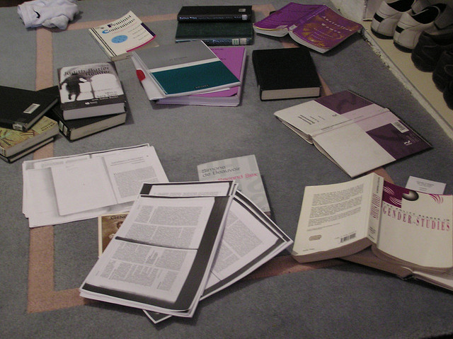 Planning materials sprawled all over the floor as a student preps for an Essay